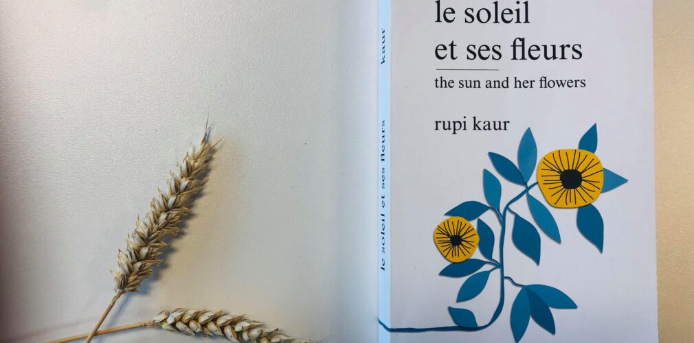 Photograph of Rupi Kaur Book on table with wheat