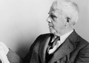 Black and white portrait of Robert Frost reading